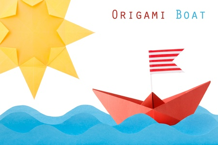 Paper origami red boat on the wave and sun on a white background Stock Photo - 20276607