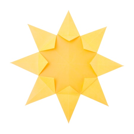 Origami hot summer yellow paper sun on a white background Stock Photo - 20269959