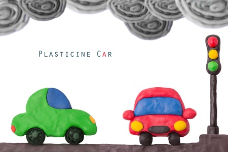 Plasticine car and traffic llight on a not ecology exhaust smog photo