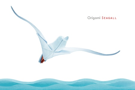 Origami paper freedom seagull bird under a waves Stock Photo - 20960400
