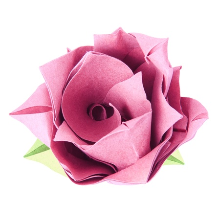 Origami paper pink vintage stile isolated rose on a white background photo
