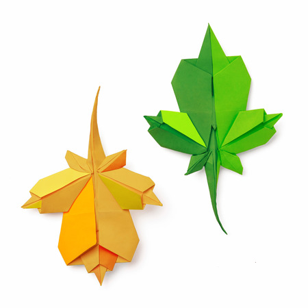 Origami paper isolated falling maple leaves on a white background photo