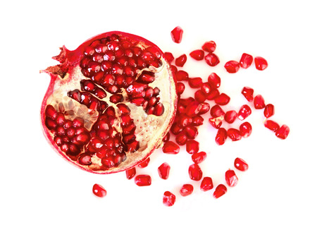 vitamine: Pomegranate fruit healthy eating vitamine on a white background