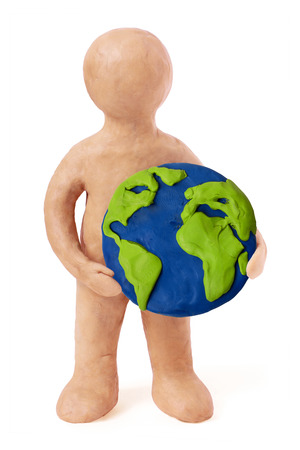 Plasticine man holding earth part on a white background photo