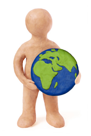 Plasticine man holding earth Europe Africa part on a white background photo