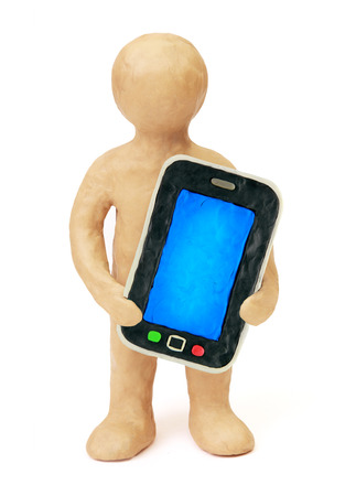 Plasticine man with smart phone mobile a white background photo