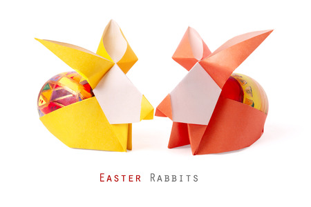 Easter handmade bunny rabbits with painted egg on a white background photo