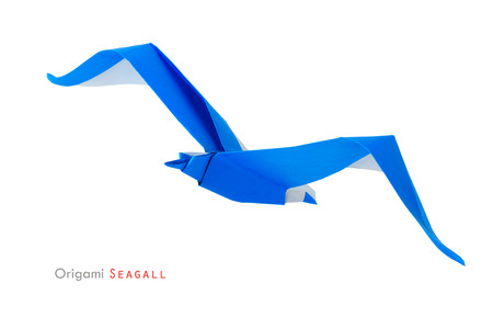 Origami paper freedom seagull bird on a white background photo