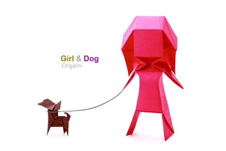 Origami pink geometric concept paper fun girl with dog on leashon a white background photo