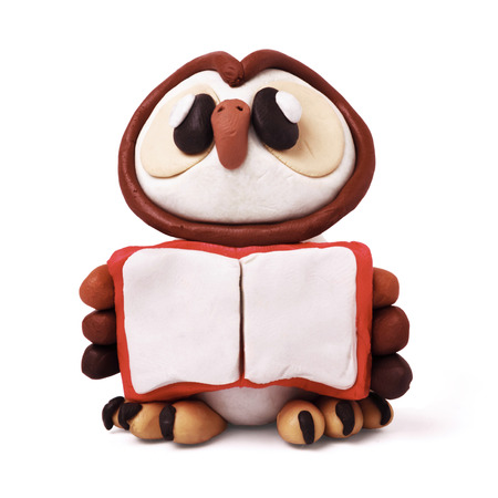 childs play clay: Plasticine cartoon education isolated owl  with book on a white background