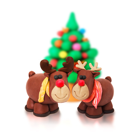 cute couple: Couple of romantic christmas tree family cartoon plasticine deers on a white background