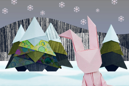 snow forest: Paper origami selfie rabbit in winter christmas fir-tree in snow forest Stock Photo