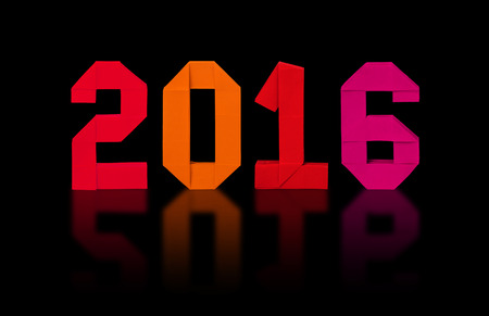 origami numbers: New year 2016 paper origami numbers on a black background Stock Photo