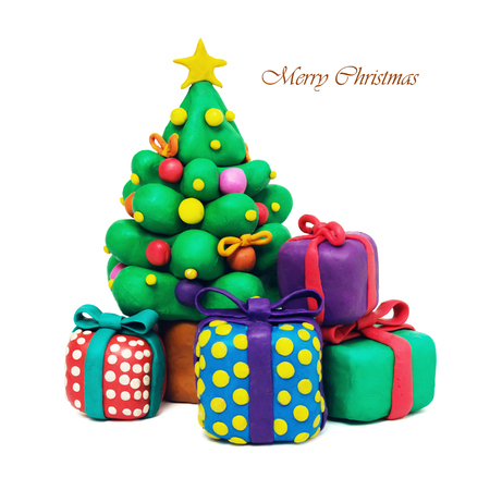 Christmas fir tree  plasticine cartoon with gift boxes on a white background