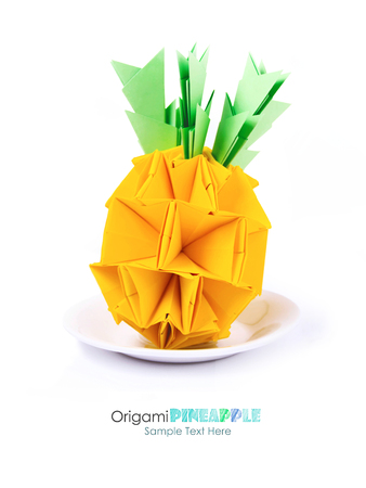 burning paper: Origami paper pineapple yellow vitamin diet tropical fruit on a white background