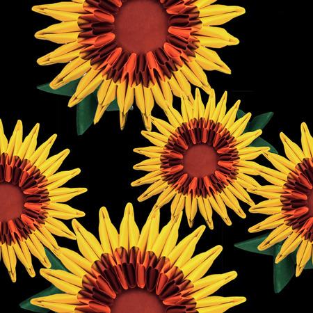 sun energy: Origami art nature sunflowers head sun energy on a black background Stock Photo