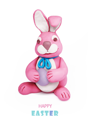 colored egg: Easter pink bunny plasticine rabbit with colored egg on a white background Stock Photo