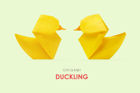 ducklings: Origami paper yellow ducklings pair floating on a mint green background Stock Photo