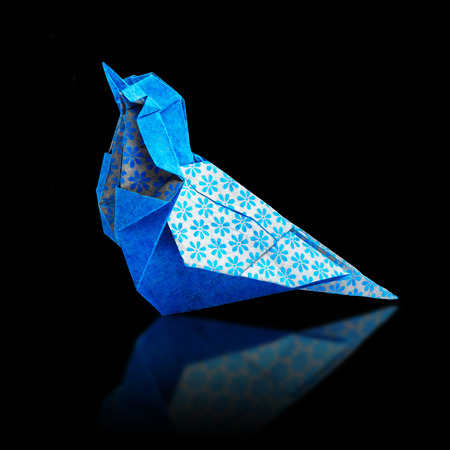 japanese people: Origami art blue and bronze metalic floral bohemia pattern paper bird on a black background Stock Photo
