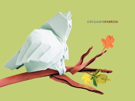 origami paper: Paper origami art sparrow bird pastel color on branch on a green background Stock Photo