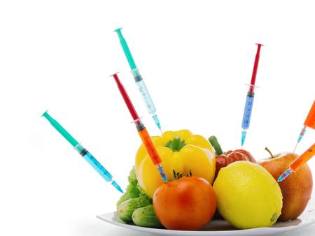 Toxic gmo vegetables modification syringeisolated on a white background