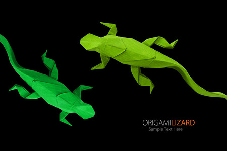 Origami paper art  green wild lizards on a black background Stock Photo