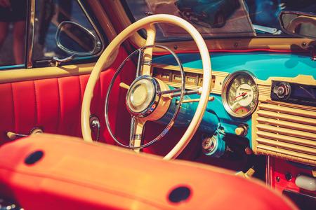 Orange blue retro vintage style car salon wheel Stock Photo