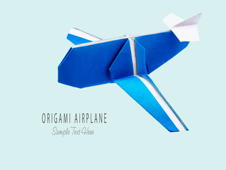 Origami blue cartoon paper travel isolated airplane on blue background Stock Photo