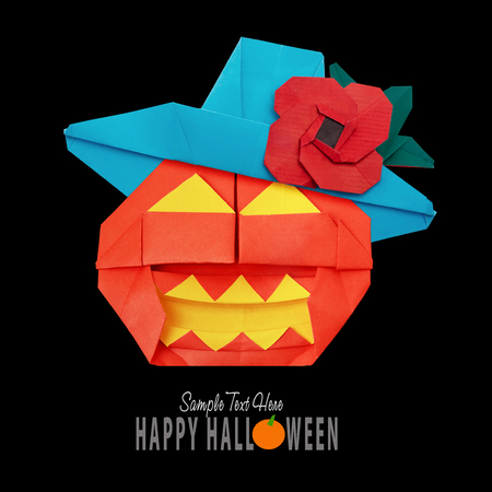 Origami Funny Halloween Pumpkin With Black Hat Isolated On Black