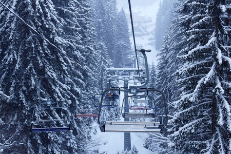 Winter forest snow ski lift trace mans on snow background