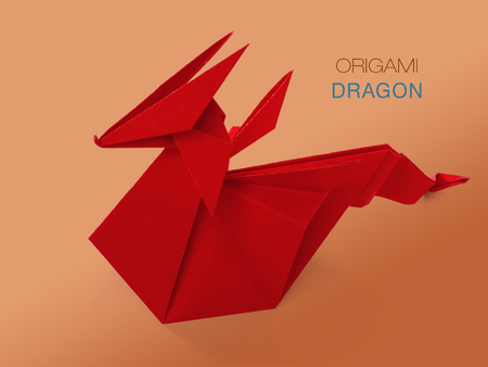 Origami red paper dragon Stock Photo