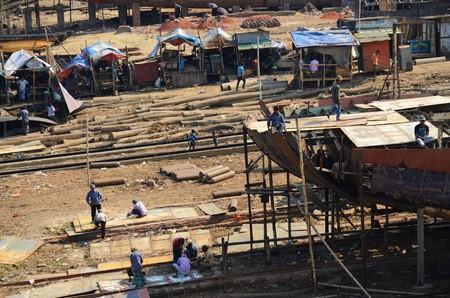 locals: DHAKA, BANGLADESH - NOVEMBER 2: Locals are working at a dockyard on November 2, 2014 in Dhaka, Bangladesh