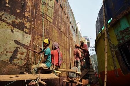 2 november: DHAKA, BANGLADESH - NOVEMBER 2: Local workers are repairing a ship in a dockyard on November 2, 2014 in Dhaka, Bangladesh