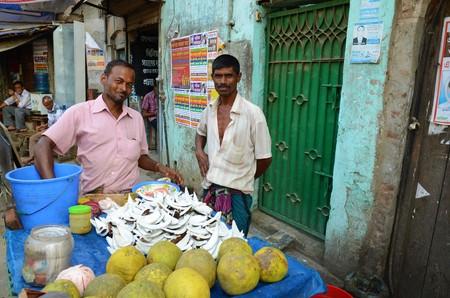2 november: DHAKA, BANGLADESH - NOVEMBER 2: Two men are selling coconuts on the streets on November 2, 2014 in Dhaka, Bangladesh