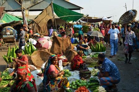 2 november: DHAKA, BANGLADESH - NOVEMBER 2: Locals are selling and buying fruits and vegetables at the food market on November 2, 2014 in Dhaka, Bangladesh Editorial