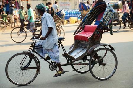 streetlife: DHAKA, BANGLADESH - NOVEMBER 2: A close-up of a rickshaw driver on the streets on November 2, 2014 in Dhaka, Bangladesh Editorial