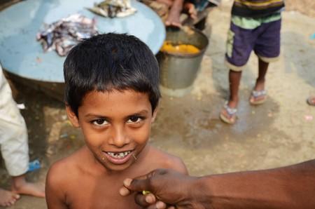 2 november: DHAKA, BANGLADESH - NOVEMBER 2: A Closeup of a child on a fishmarket on November 2, 2014 in Dhaka, Bangladesh