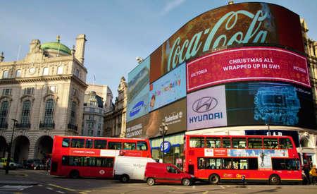 piccadilly: LONDON, UK - NOVEMBER 23: Red London buses on the street in Piccadilly Circus on November 23, 2015 in London, UK.