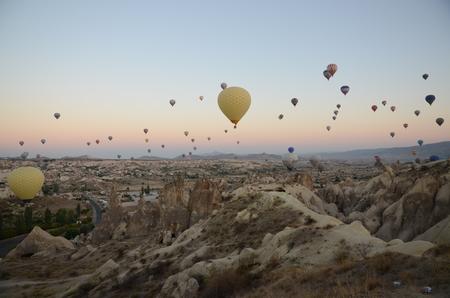 honeycombed: Cappadocia, Turkey - SEPTEMBER, 13: Hot air balloon flying over rock landscape on September 13, 2014 in Cappadocia, Turkey Editorial