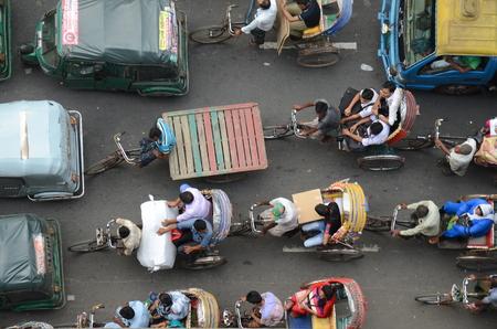 dhaka: DHAKA, BANGLADESH - CIRCA November 2014: Traffic jam with rickshaws in Dhaka and tuk tuks, aerial view circa November 2014 in Dhaka, Bangladesh