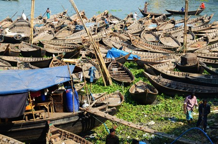 loads: DHAKA, BANGLADESH - NOVEMBER 2: Loads of boats are parked on the Buriganga River on November 2, 2014 in Dhaka, Bangladesh
