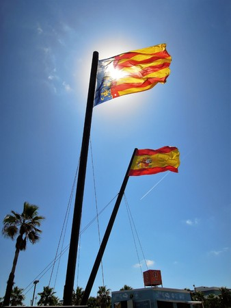 valencia: VALENCIA. SPAIN - CIRCA August 2015: Flag of Valencia and Spain waving in the wind circa August 2015 in Valencia, Spain.