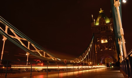panning shot: Low angle shot on the Tower Bridge in London, panning by night