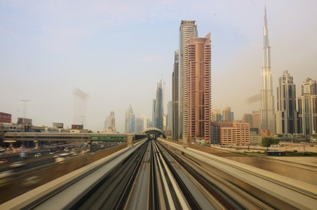 panning shot: A panning shot of the train tracks in Dubai with the city in the background Stock Photo