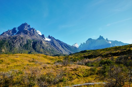 bariloche: PUNTA BARILOCHE, Torres del Paine NATIONAL PARK, CHILE - FEBRUARY 6, 2016: View from a green and brownfield Onto Punta Bariloche mountainrange Stock Photo