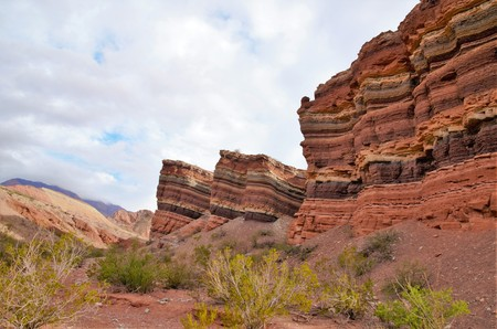 Impressions of the Canyon Quebrada de las Conchas with walls of rock displaying layers with several different colors close to Cafayate in Chile, South America