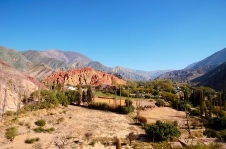 siete: Long shot of the seven color hill or cerro de los siete colores in the village Purmamarca in the canyon quebrada de humahuaca in Jujuy, Argentina, South America