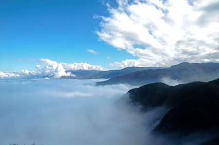 View over the clouds on top of the hill Cerro Arco close to Mendoza in Argentina, South America