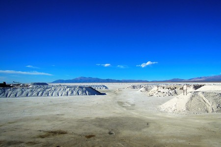 sierras: Long shot of the Salinas Grandes salt flats in North Argentina at the foot of the Sierras de Cordoba mountain range in South America