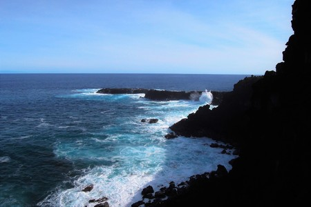 View over the sea at the Ana Kakenga Cave close to Hanga Roa the capital of Easter Island, Rapa Nui, Chile, South America Stock Photo